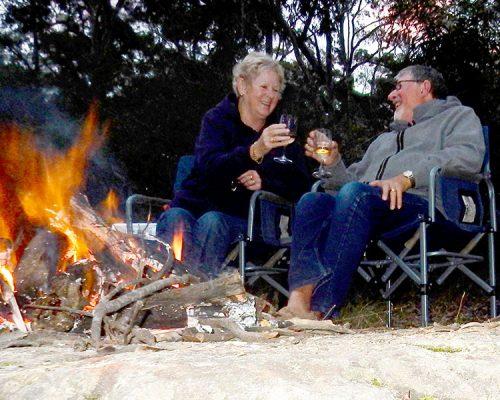 Gordon and Barbara Campbell ejoy a vino round the campfire