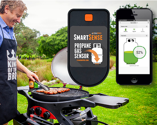 An outdoor BBQ cook is happy because he has a SmartSense gas monitor to warn if he is low on gas