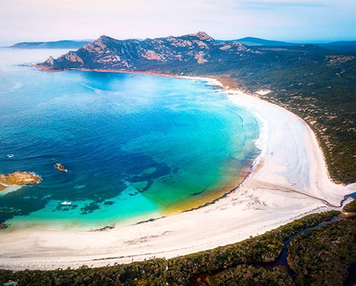 Ariel of beach on Flinders Island Tas . Shows northernmost point where 67yo female hiker fell, needing rescue helicopter to winch hre to safety. rescue