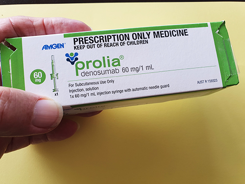 Hand holds Prolia package